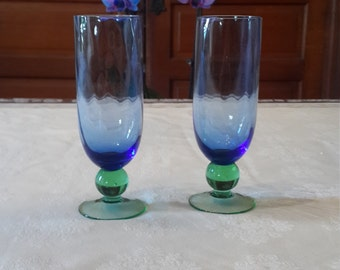 Blue glasses with green bottom tall thin