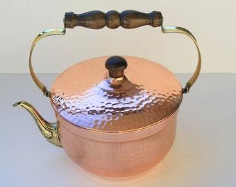 Copper handicraft teapot. Handmade