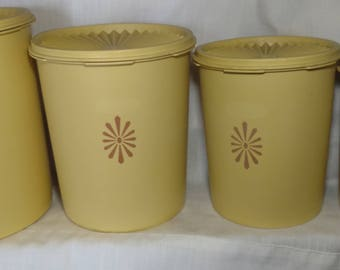 Complete set of four 4 Retro Tupperware Canisters 60s plastic canisters Yellow Orlando Florida sixties 807-8 antique free shipping in US