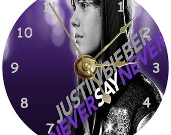 Justin Bieber on a clock face that is printed on a standard 12 cm cd disc plus stand