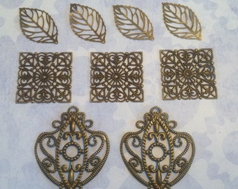 Beautiful filigree set, chandelier, ornate square, and autumn leaf. (Set of 9)