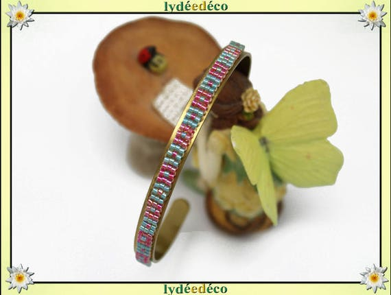 Bangle is 6mm pastel green turquoise and pink weaving Japanese glass beads and brass