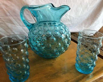 Turquoise bubble glass pitcher with two matching glasses