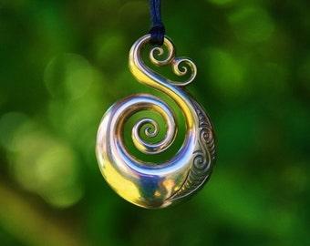 Solid Bronze Maori Koru Pendant on black adjustable cord.