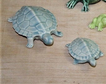 Turtles, small and large with four colors to choose. Fit nicely in a planter, terrarium, nook or beta tank. Too cute. Made from 1960's mold.
