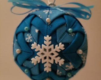 Blue folded fabric handmade ornament with white snowflake decoration