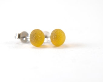 Etched marigold yellow stud earrings with surgical steel earring posts, frosted fused glass