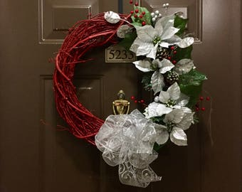 Red Wooden Grapevine wreath with Silver & White Poinsettias and silver bow.