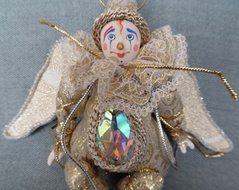 Little gold decoration angel clown.Hand made doll with hand painted porcelain face.Christmas decoration. Angelwings. Unique doll
