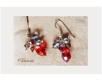 simplicity, elegance to these earrings in sterling silver and its red and grey crystals