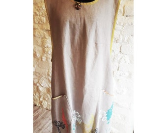 Grey Linen Apron Dress with screen printed design & pocket detail.