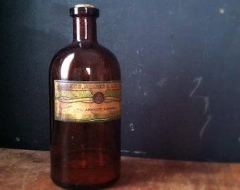 "Antique Amber Pharmacy Bottle - Magnus, Mabee & Reynard 8"" Oil Apricot Kernels"