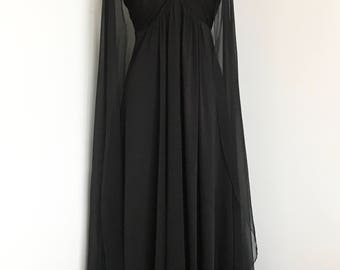 Vintage • Black evening gown with sheer full-length cape sleeves • Fits a US women's size Small