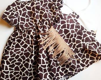 Giraffe print baby girls dress with matching fringe bib