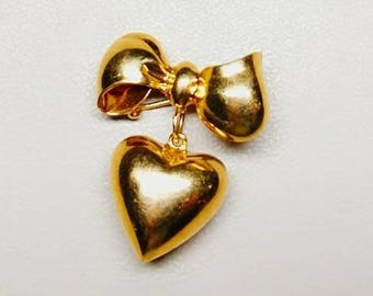 Vintage, mid century, gold bow with dangling heart brooch or pin.  Simply charming.  Excellent.