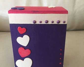 Little girl wooden money box