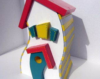 Whimsical painted curvy birdhouse