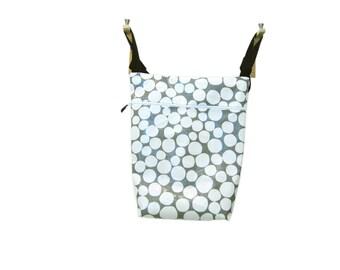 Gray stroller bag with big white polka dots