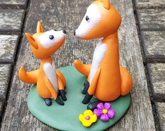 Fox parent and child polymer clay sculpture