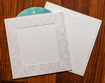 DVD Cases / Sleeves - 100 white on white sleeves with Photo Opening on front