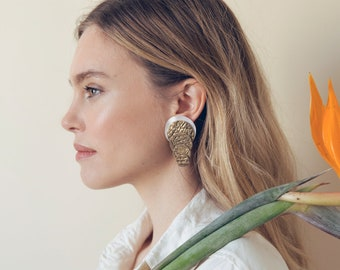 Round golden leather earrings with white silk for women