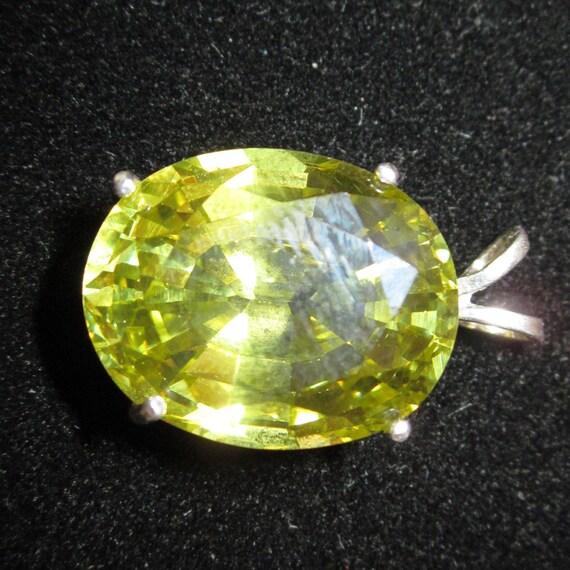 Olive Green Pendant, faceted gemstone, silver bezel 55ct