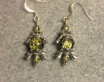 Silver frog bead cap dangle earrings around large olive green Czech glass beads.