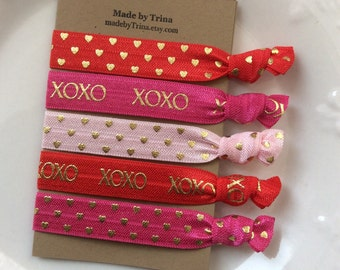 Red and pink XOXO Valentine hair tie bracelet set