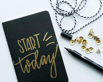 Mini gold embossed moleskine - start today