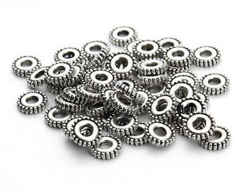 10 beautiful beads rondelle spacers in antique silver large hole 3mm approx.