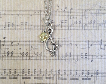 Treble clef silver charm necklace with light yellow Swarovski crystal accent