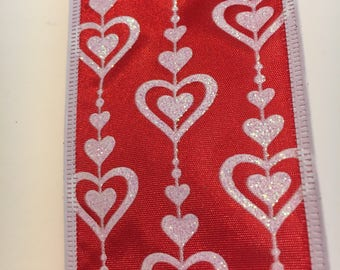 Red Valentine ribbon printed with white hearts