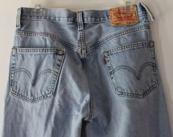 Vintage LEVI'S LEVI STRAUSS W30 L34 light wash high waisted denim jeans