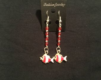 Beautiful red and silver dangling earring with  a fish charm on the end