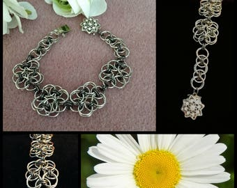 Four Helm's Weave Flowers Highlight This Bracelet of Imitation Rhodium w/ Floral Rhinestone Box Clasp