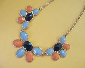 Plastic faux stone necklace with gold tone chain 19 inch no markings