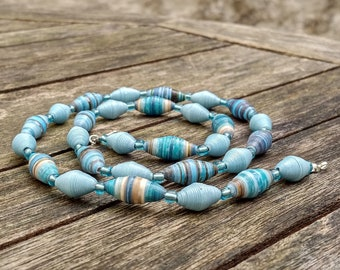 Handmade necklace with blue - beige - light blue recycled paper and light blue glass beads