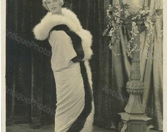 Beautiful woman actress in fur coat antique photo