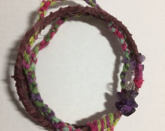 Bracelet; batik and colourful braiding, with tumbled amethyst