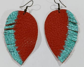 Large orange leather feather earrings with turquoise tips