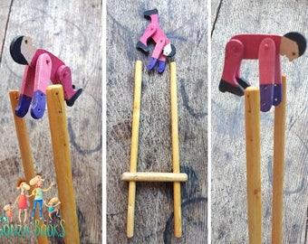 Handmade rotating acrobat squeeze toy