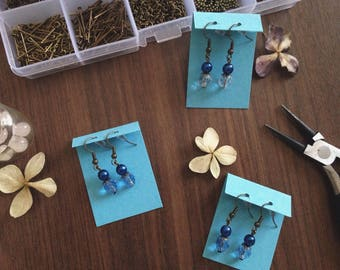 Dangling earrings with blue and azure beads.