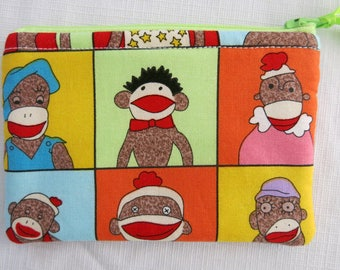 Sock monkey zippy pouch colorful print with primary colors and sock monkies red green blue yellow monkies
