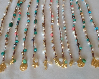 Beachy and Zen Beaded Bracelets Braided with Healing Gemstones, Freshwater Pearls, and Shells.