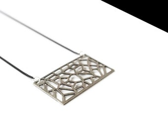 Silver tone openwork plate necklace.