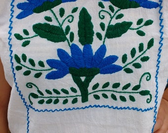 Beautiful blanket blouse with embroidery, with vivid blue color....