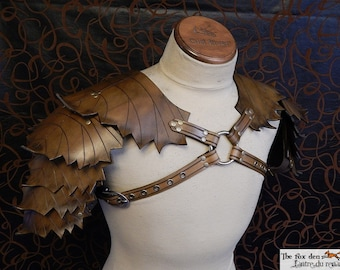 Leather leaf shoulder armor, spring or fall color. Perfect for wood elf or nature related character.