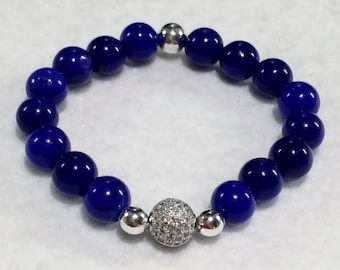 10mm Blue Jade beads with one 12mm Silver plated Micro Pave' CZ bead bracelet