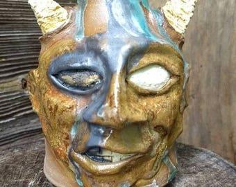 smirking devil FACE JUG by Joel Patton, applied glaze design