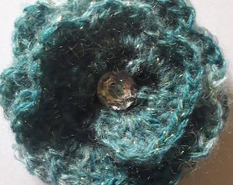 Blue wool spiral flower brooch with diamante button. Hand crocheted.
